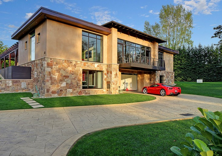 Car Lover? You'll Like This Two-Bedroom Home With A 16-Car