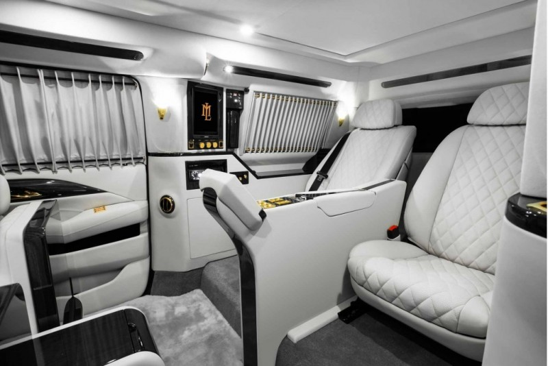 lexani turns the 2016 escalade into an opulent lounge american luxury. Black Bedroom Furniture Sets. Home Design Ideas